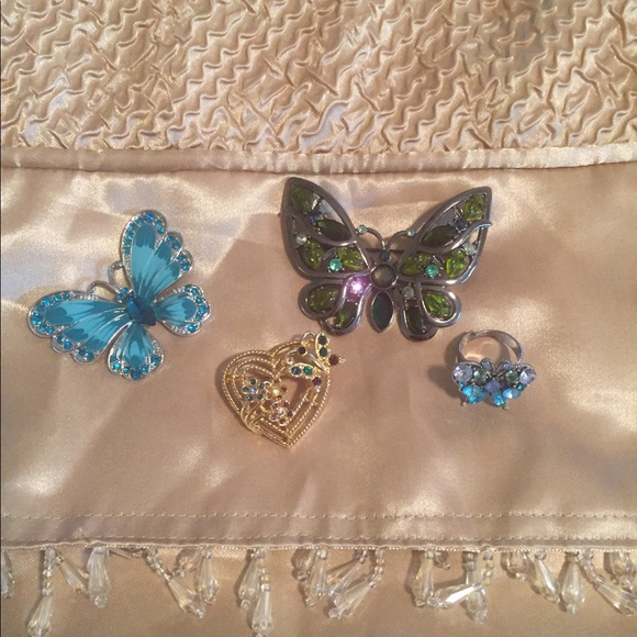 Butterfly pendants and a ring.